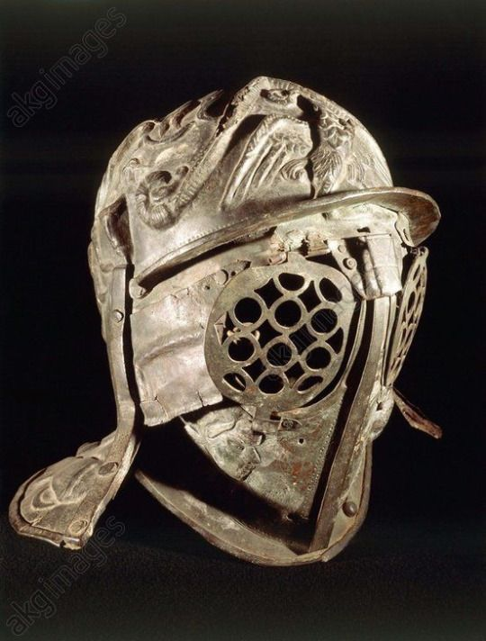 Roman gladiatorial helmet, 1st century A.D. Gladiatorial parade bronze helmet, from Pompei. Museo Archeologico Nazionale di Napoli