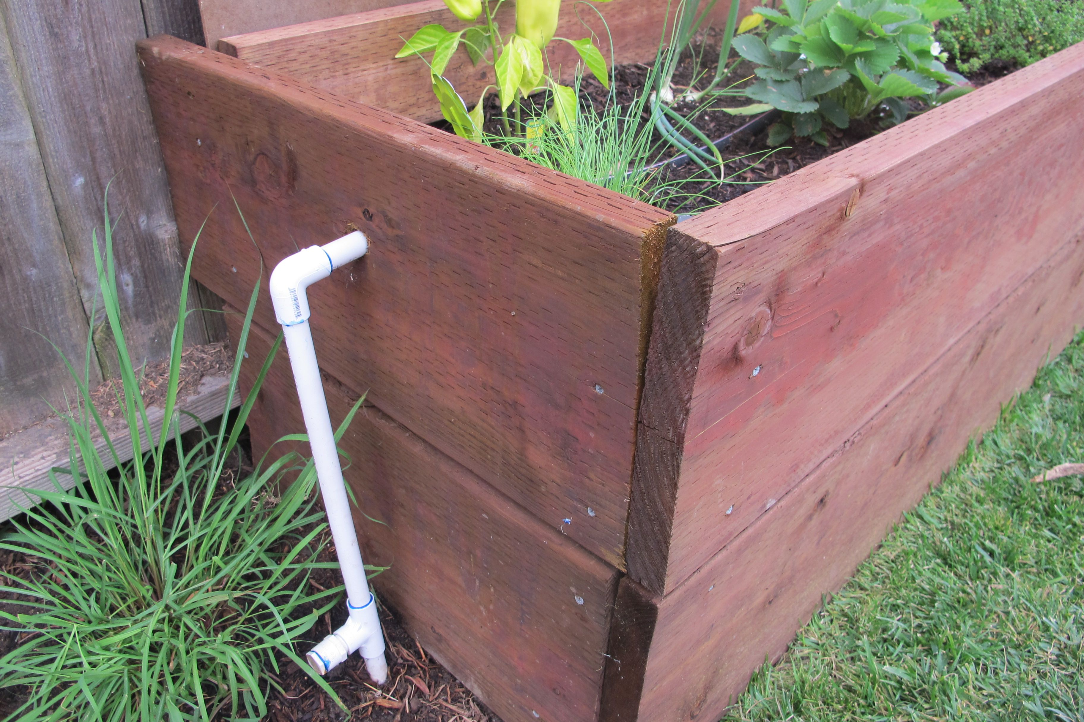 Adding automatic watering systems to raised flower or in
