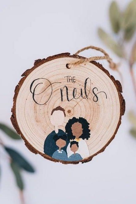These ornaments are personally made by hand on natural wood, perfect for your family tree or a personalized gift.