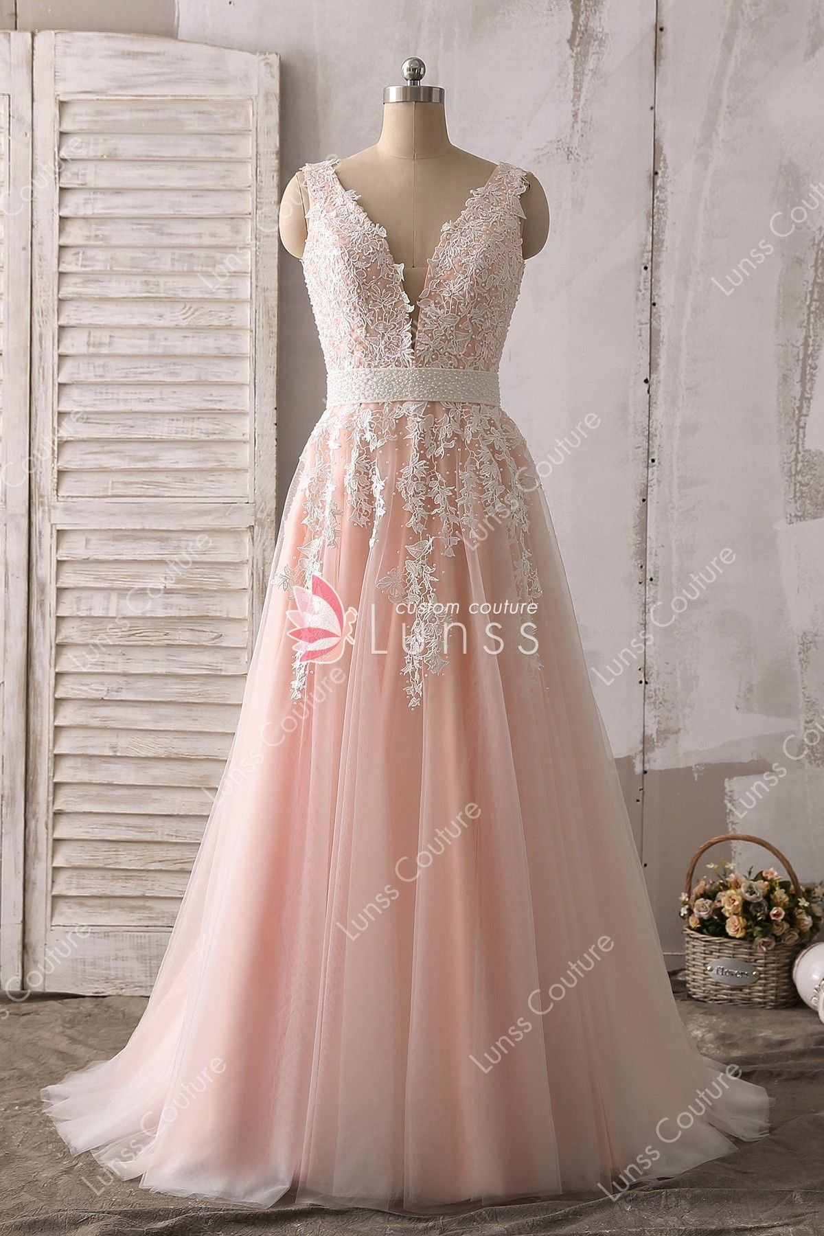 58feb8f173a This pink A-line prom dress is embellished with lace appliques and high  quality ivory