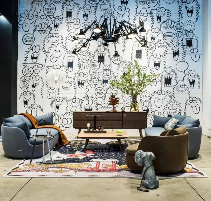 Wohnlandschaft mit Polstermöbel und buntem Designer Teppich | Loving ...