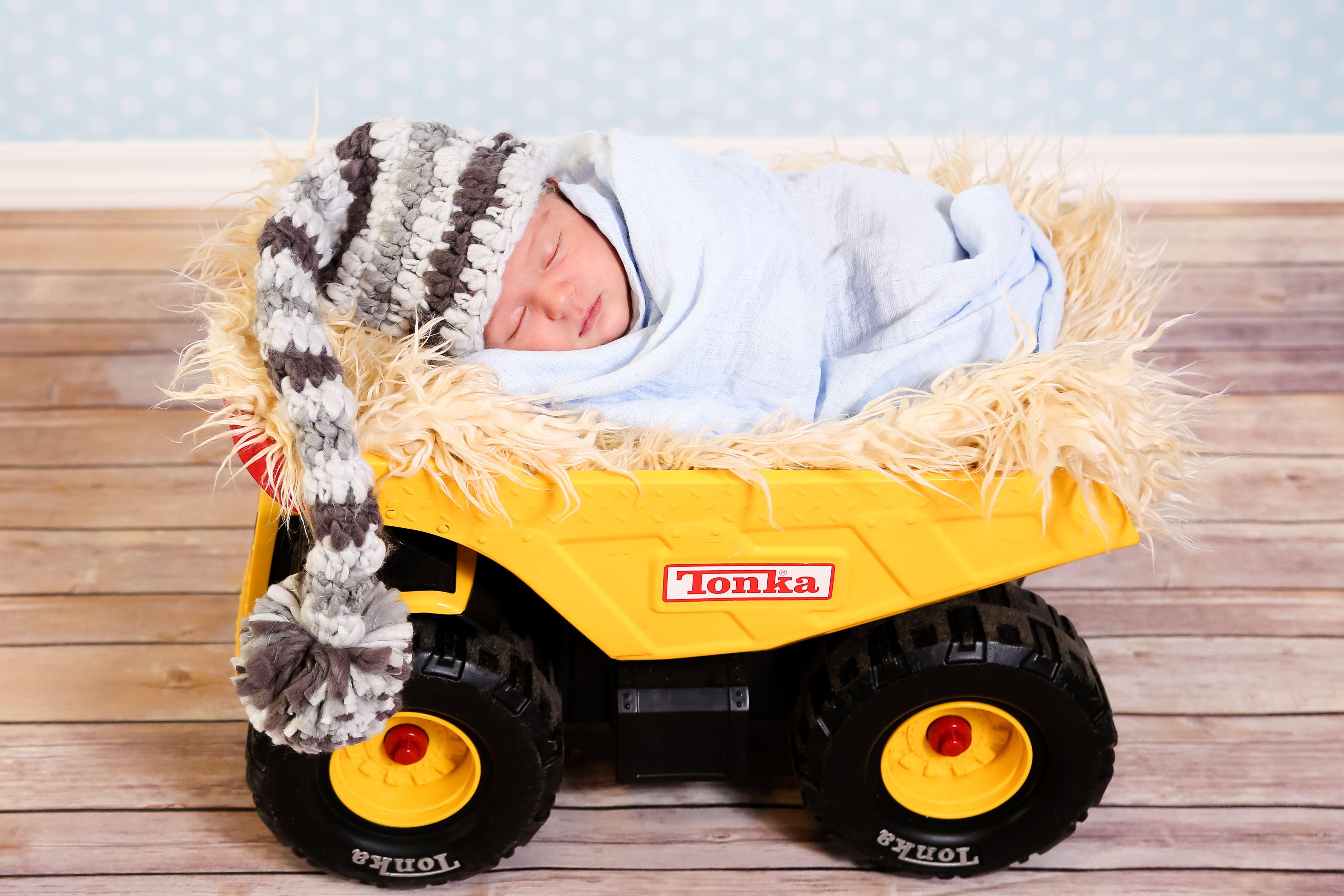 Baby boy in tonka truck photograph