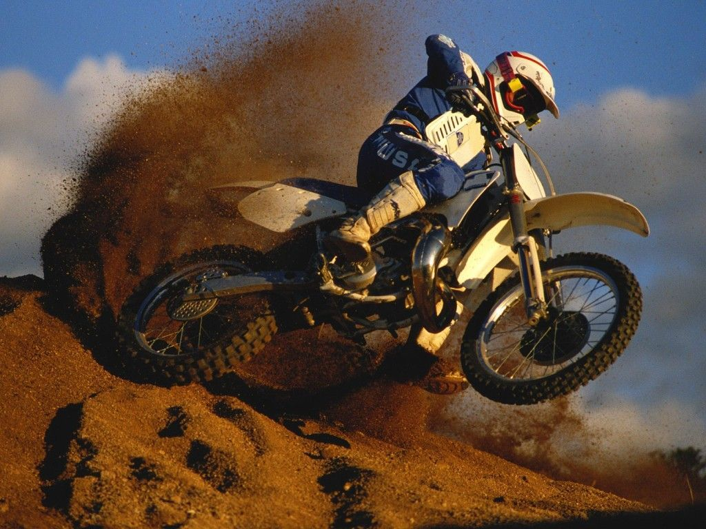 Man On A Dirt Bike Long Tail Of Sand Behind Him Motocross