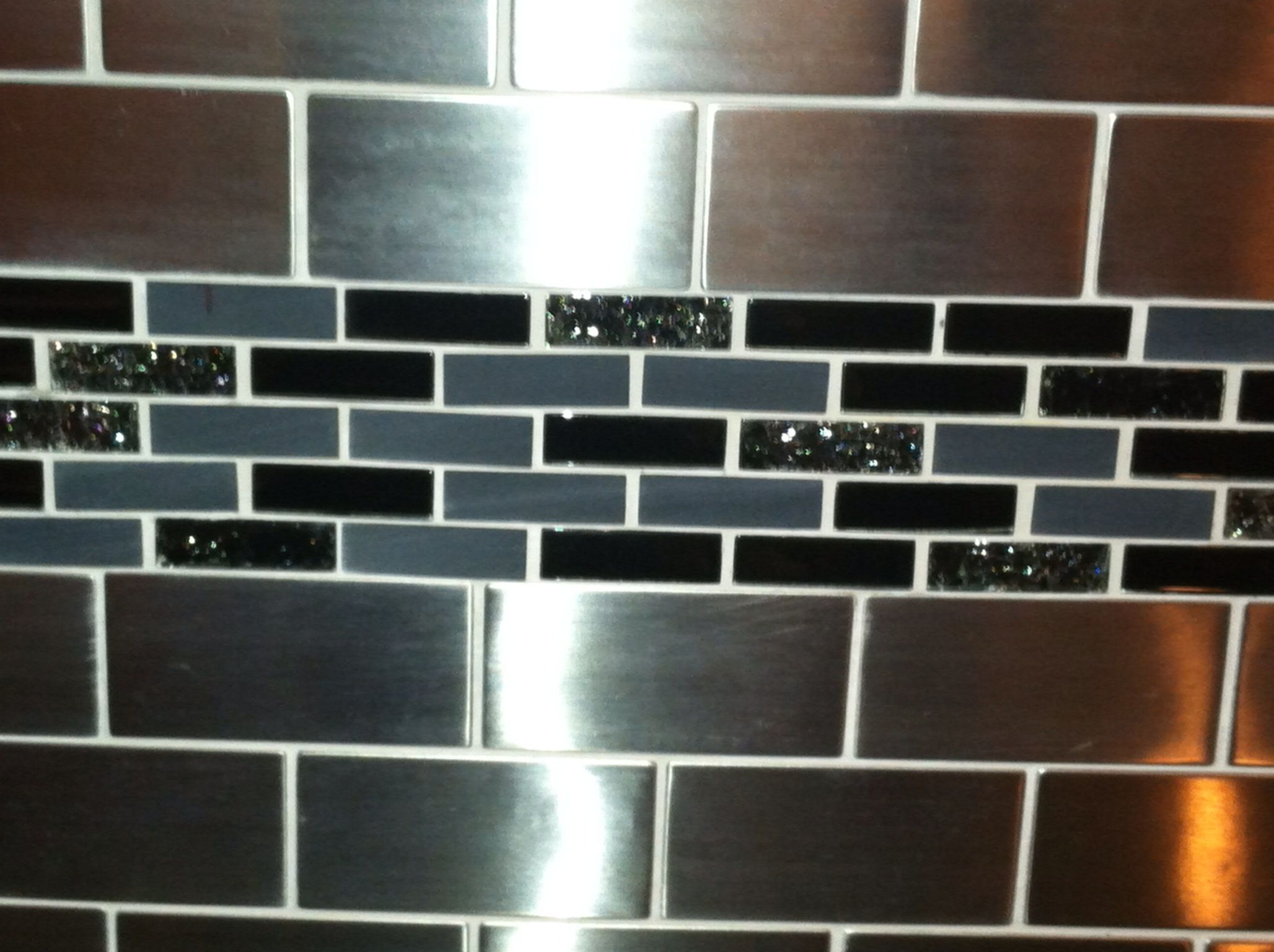 stainless steel tile mixed with shatter glass tiles we came up with