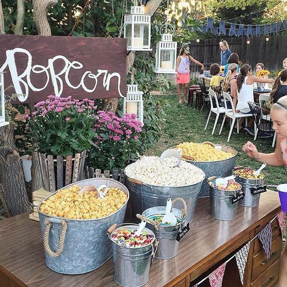 rustic popcorn bar with buckets and bathtubs with popcorn and toppings and som...   - Recipe - Party -