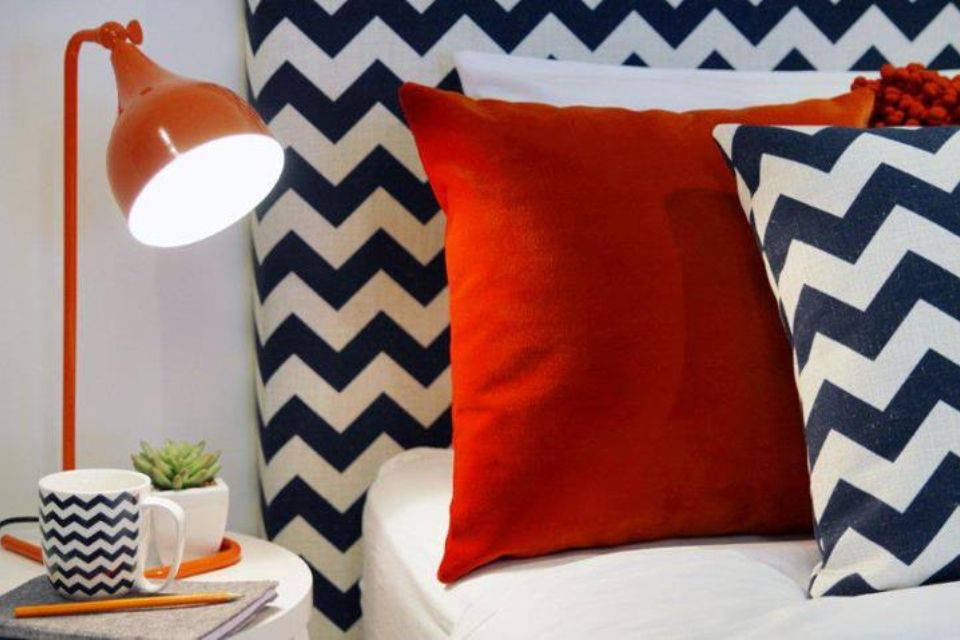 Navy chevrons pop against the red fabric of these pillows.