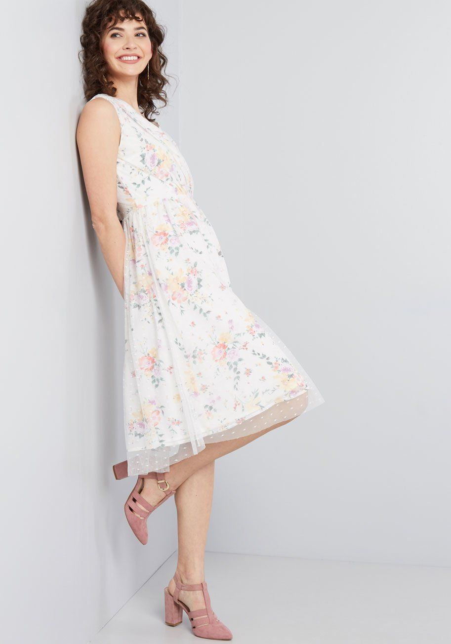 0a27598d87 Favor the Feminine Floral Dress This white dress delightfully displays your  preference for dainty