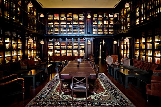 The library at The NoMad Hotel. Don't love the seating area but I like the color of the wood for a home library.
