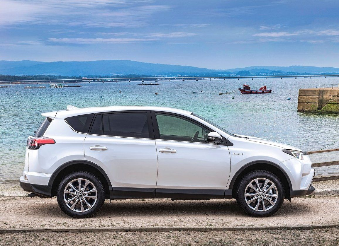 2017 Toyota RAV4 exterior, side view, white color, alloy ...
