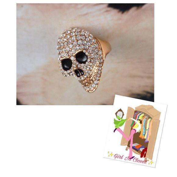 Rhinestone skull ring Gold plated. Skulls face is made of rhinestones with black slits for the eyes and nose Jewelry Rings