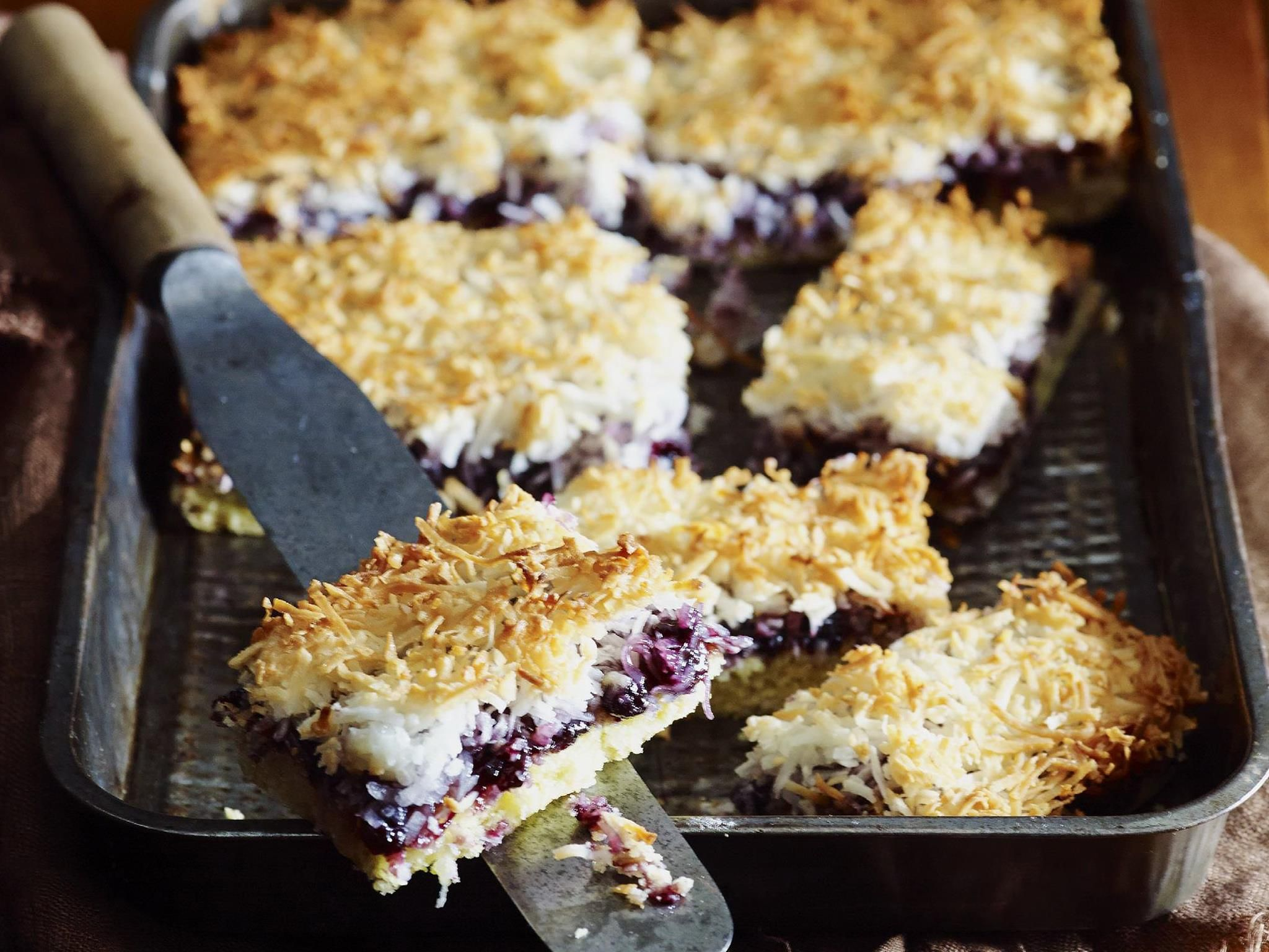 Fill the tins with this delectable, crunchy-topped blueberry slice.