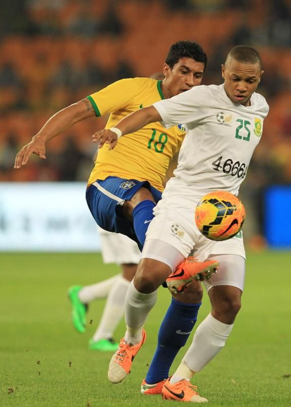 South Africa S Andile Jali Right Is Challenged By Brazil S Paulinho Left During Their International Friendl Soccer Match Soccer City Stadium World Football