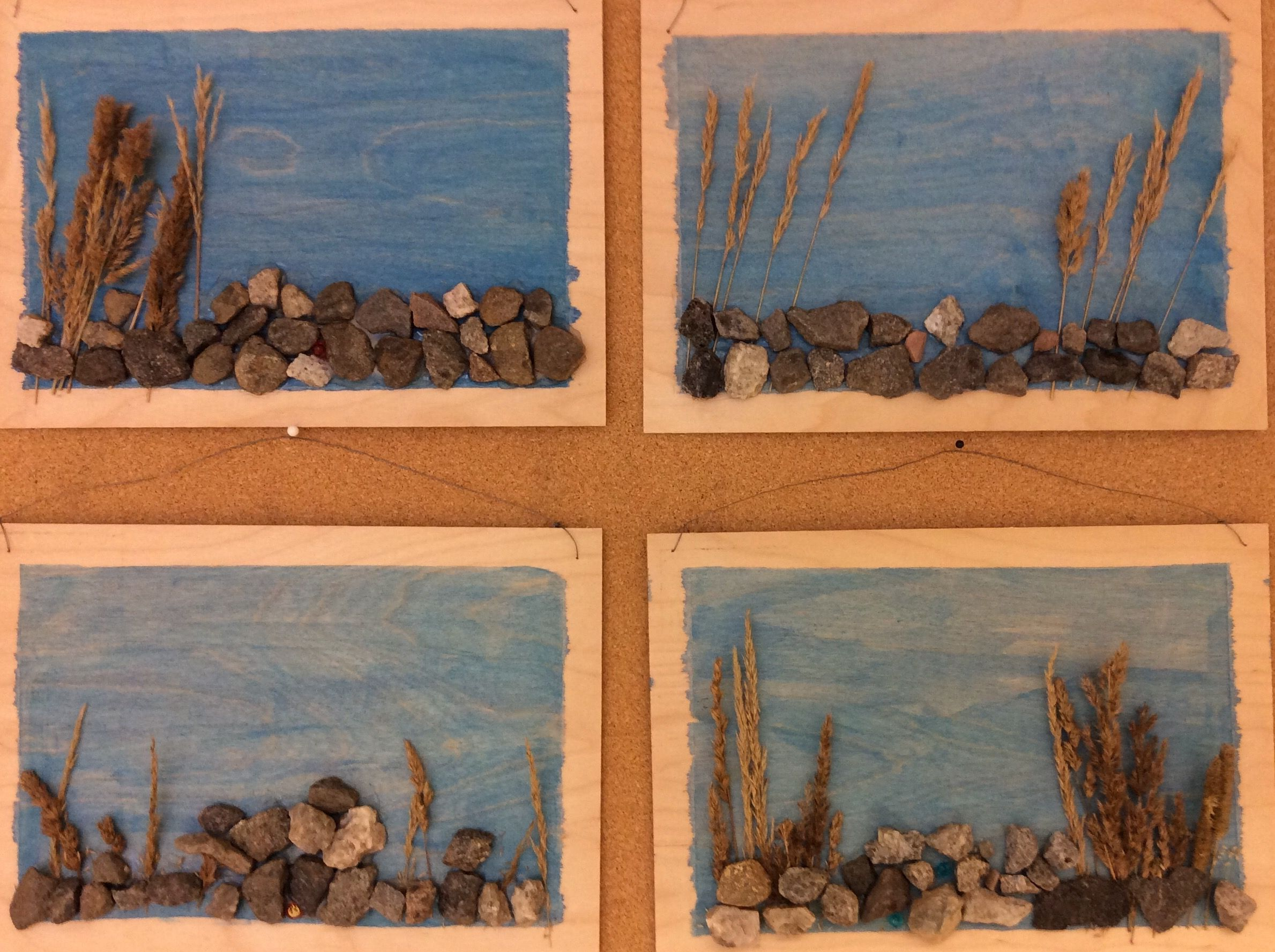 Kiviä ja heinää peitevärein maalatulla vanerilla