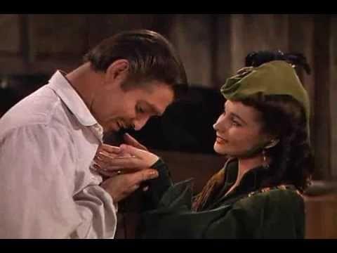 Rhett kisses Scarlett's hands and discovers her deception.
