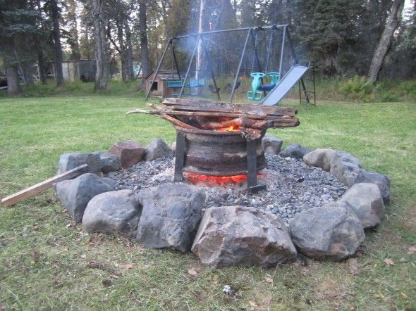 The Diy Upcycled Fire Pit Made From A Semi Truck Tire Rim And Rocks That Were In Our Yard Diy Fire Pit Upcycled Fire Pit Diy Upcycled Fire Pit