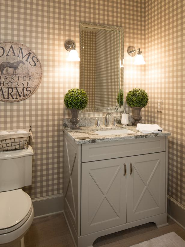 25 Clever Ways To Decorate Above The Toilet One Thing Three Ways Hgtv Bathroom Wallpaper Powder Room Ideas Elegant Amazing Bathrooms