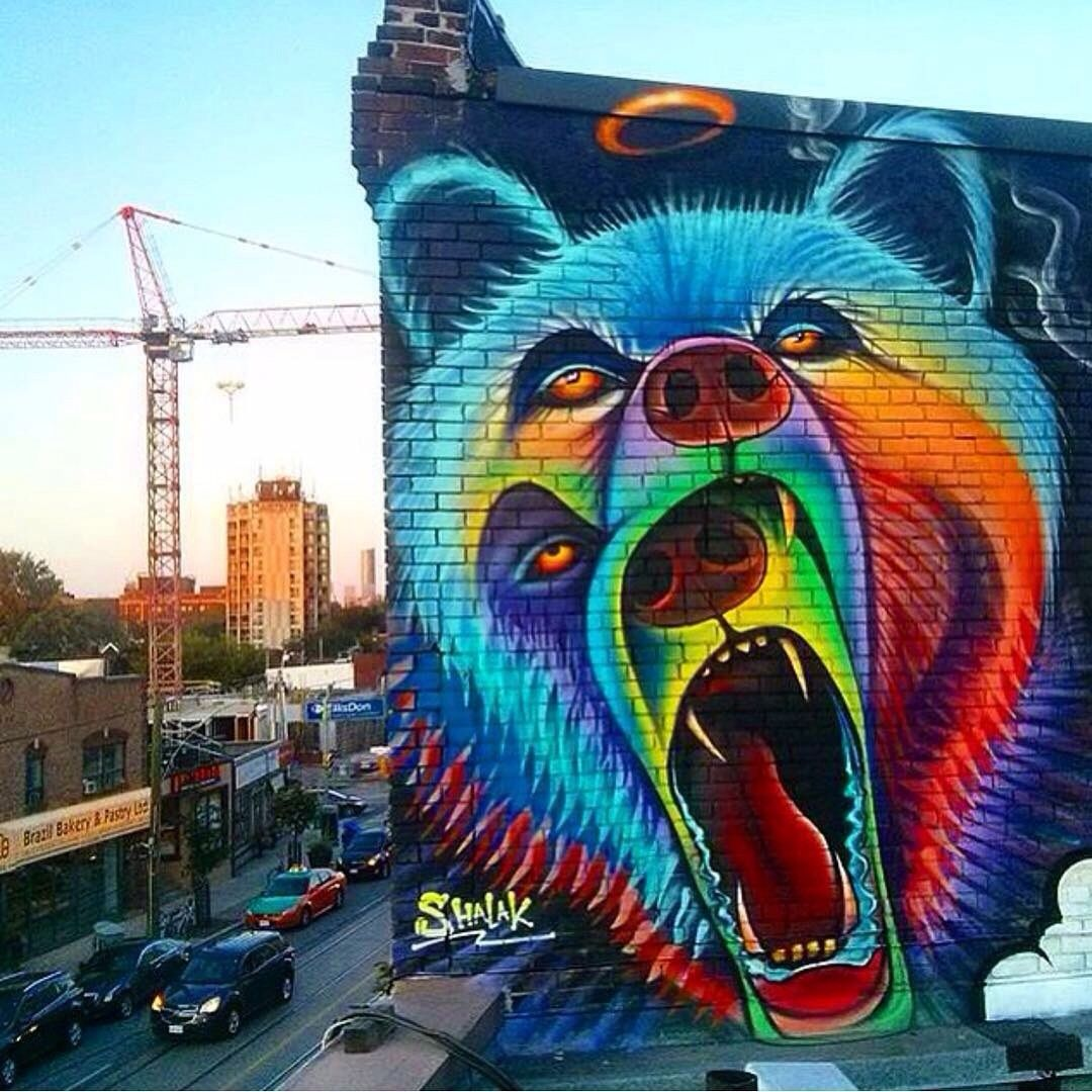 Colorful bear mural street art in ...