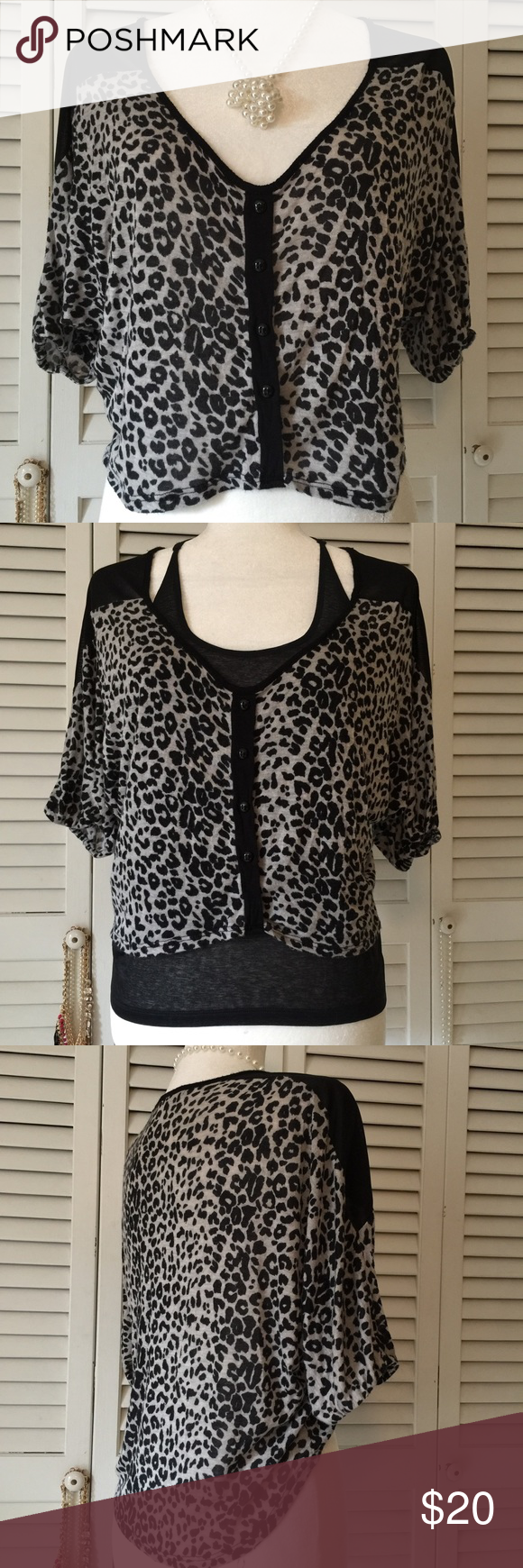 "Charlotte Russe Size Small High low top Animal print high low Top.  Poly/Spandex blend.  Loved but great condition.  Sleeves are 3/4 length. Front Measures approx 18"" and back 21"".  Sleeves are very loose and has some loose elastic on hem.  Can be worn on or off one shoulder.  So many ways to wear this.  One is shown in second photo.  I paired it with the Nike Razor back Tee also listed in my closet. Charlotte Russe Tops Crop Tops"