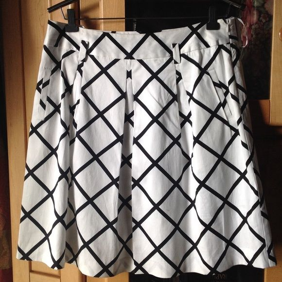 "INC Black and White Skirt I.N.C pleaded style skirt. Made out of 97% cotton and 3% spandex with lining. Has pockets.. Length 22 1/2"". Waist approx 37"". INC International Concepts Skirts"