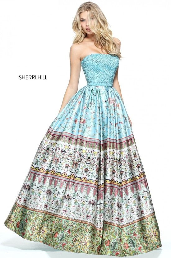 Strapless multi print ball gown with a fully beaded bodice and matching  waist band.