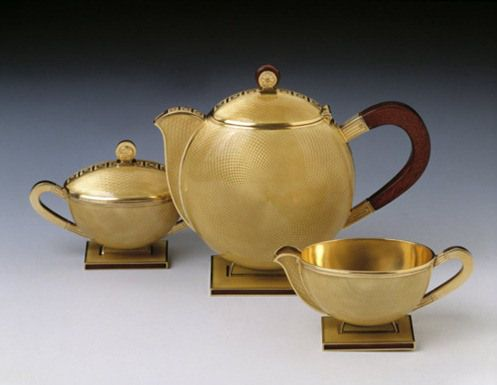 Guttorm Gagnes (1906-64).  Mocca coffee set, guilded silver, mahogany and enamel, 1931.  Made for Norwegian company David-Andersen.