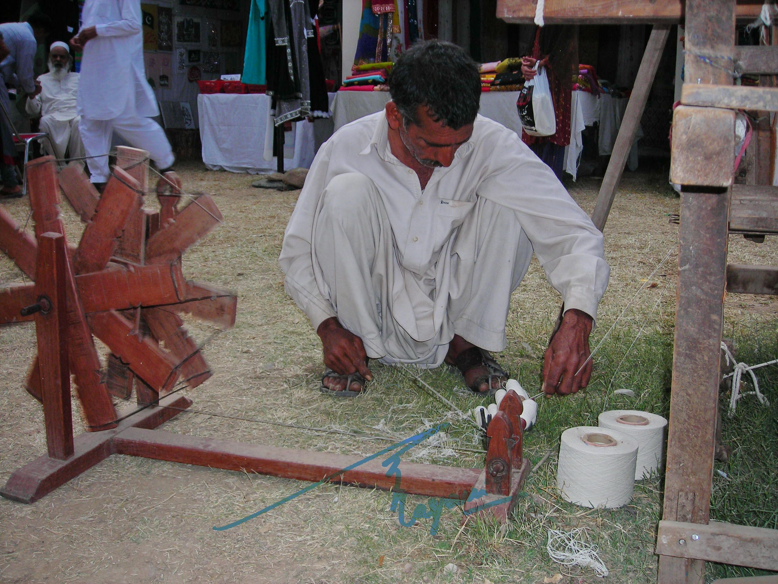 A different type of 'charkha' for khaddi thread at Lok Virsa