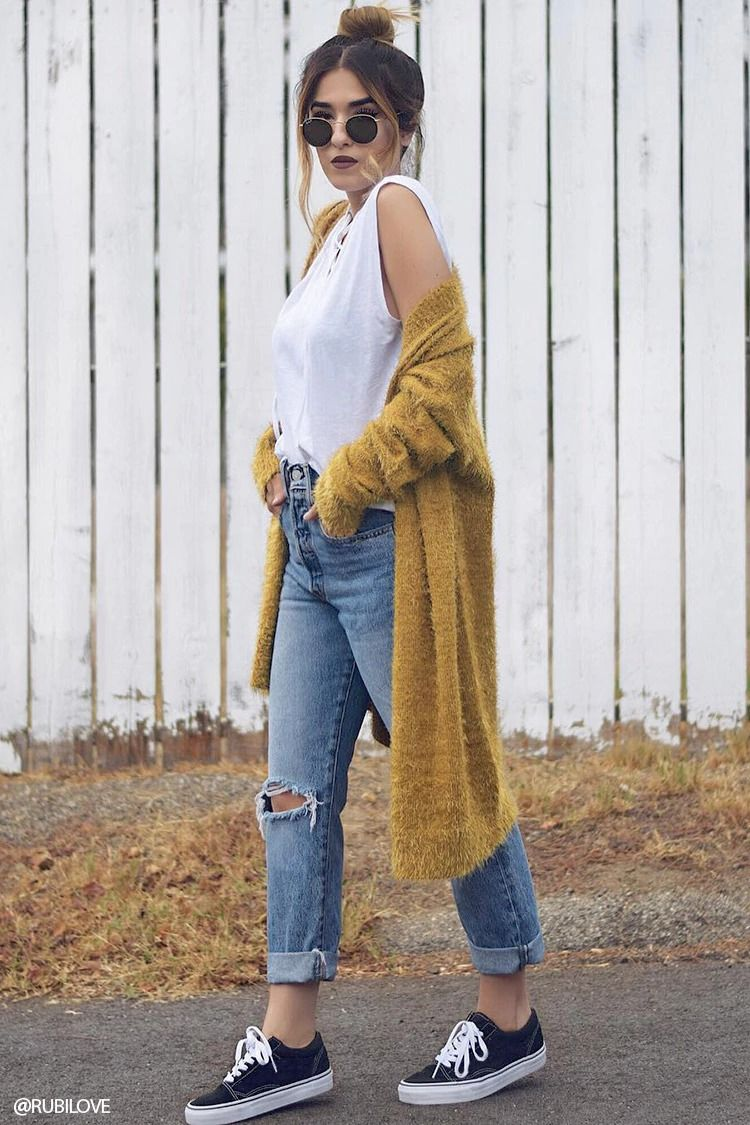 A fuzzy knit cardigan featuring a longline silhouette, an open front, and long sleeves.