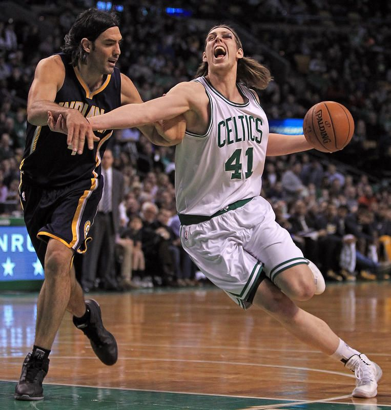r Kelly Olynyk pushes past Indiana Pacers forward Luis Scola