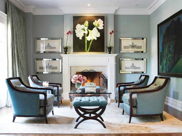 The four chairs anchoring the symmetrical room are by Baker and