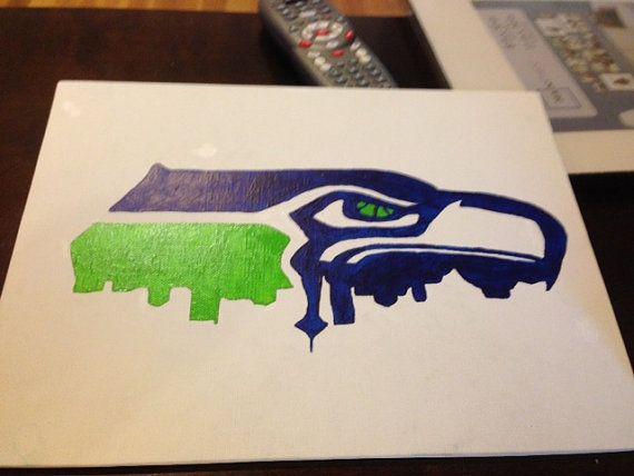 Seattle Seahawk Logo With Seattle Skyline Seattle