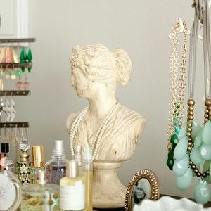 bedrooms - bust, mirrored, tray, fragrances, jewelry bust,  Vanity vignette with jewelry bust, mirrored tray and fragrances.