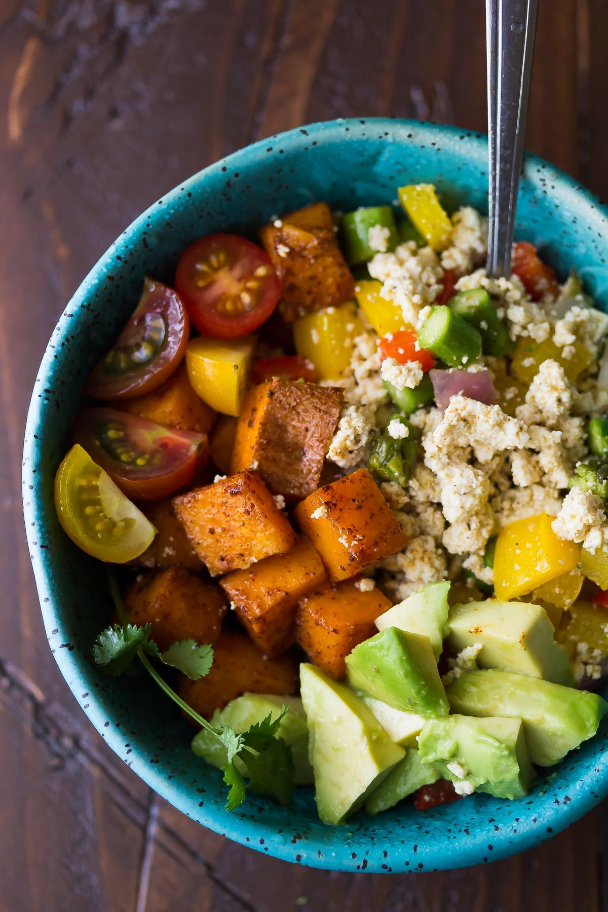 This tofu scramble and breakfast sweet potatoes is a healthy, make-ahead breakfast bowl recipe that will actually keep you full!