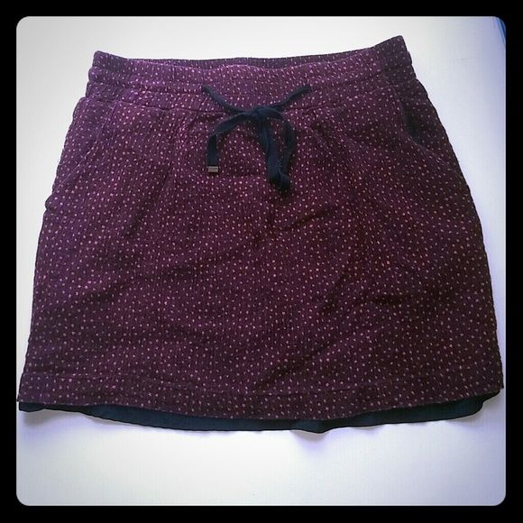 uo dotted miniskirt dark reddish with coral spots. only worn a few times, good condition. black underskirt is visible at bottom. pockets. elastic waist. slightly fitted. (idk the original price so that's a guess) Kimchi Blue Skirts Mini