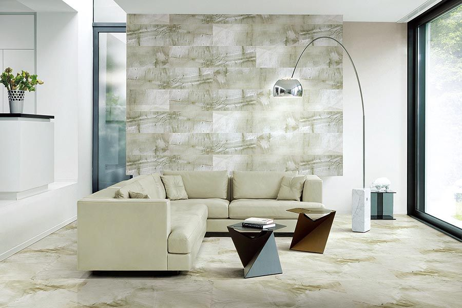 Stunning feature tiled wall in this living room is from the ultra ...