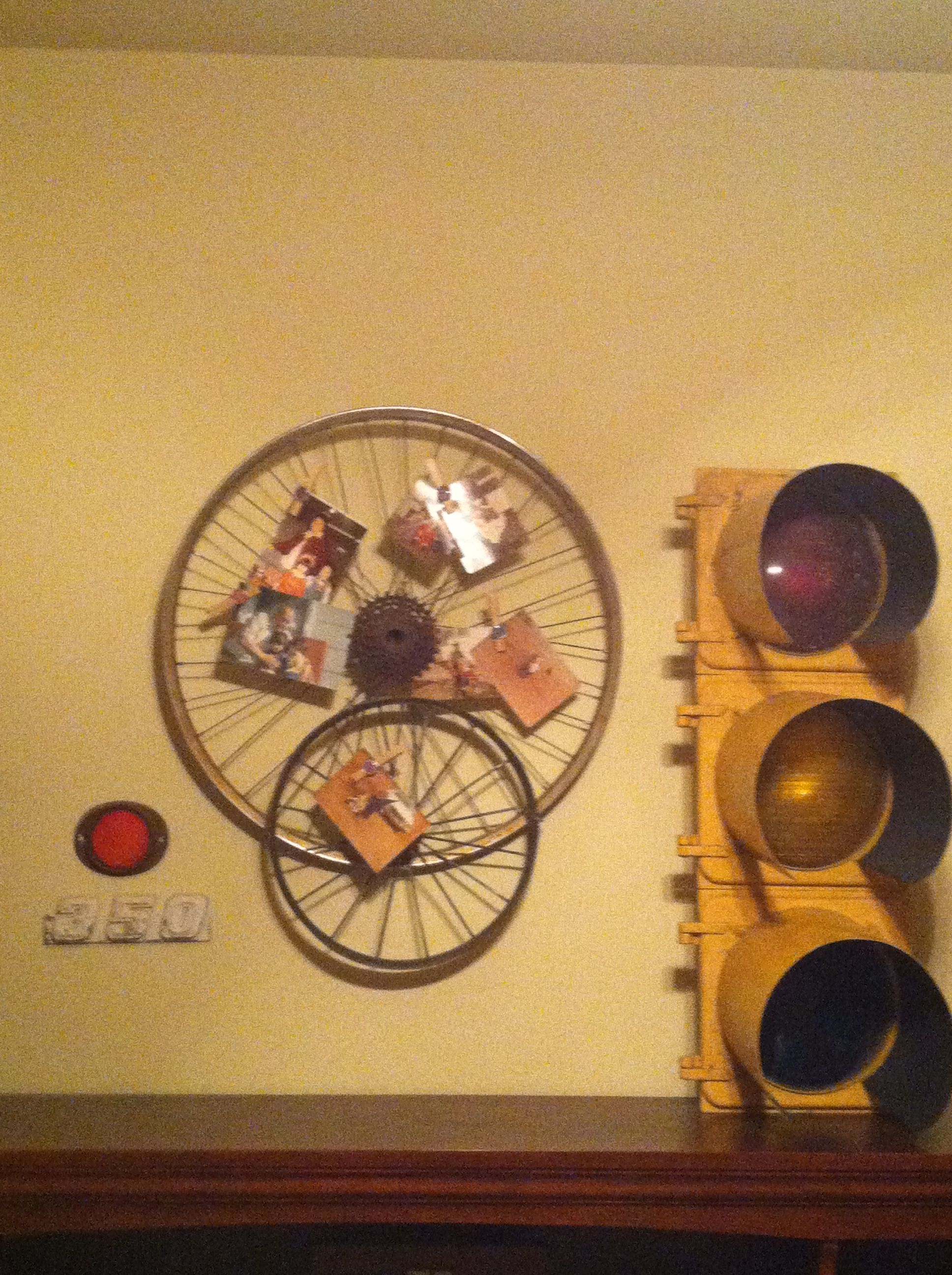 Old bike wheels from childhood made into a decorative picture frame ...