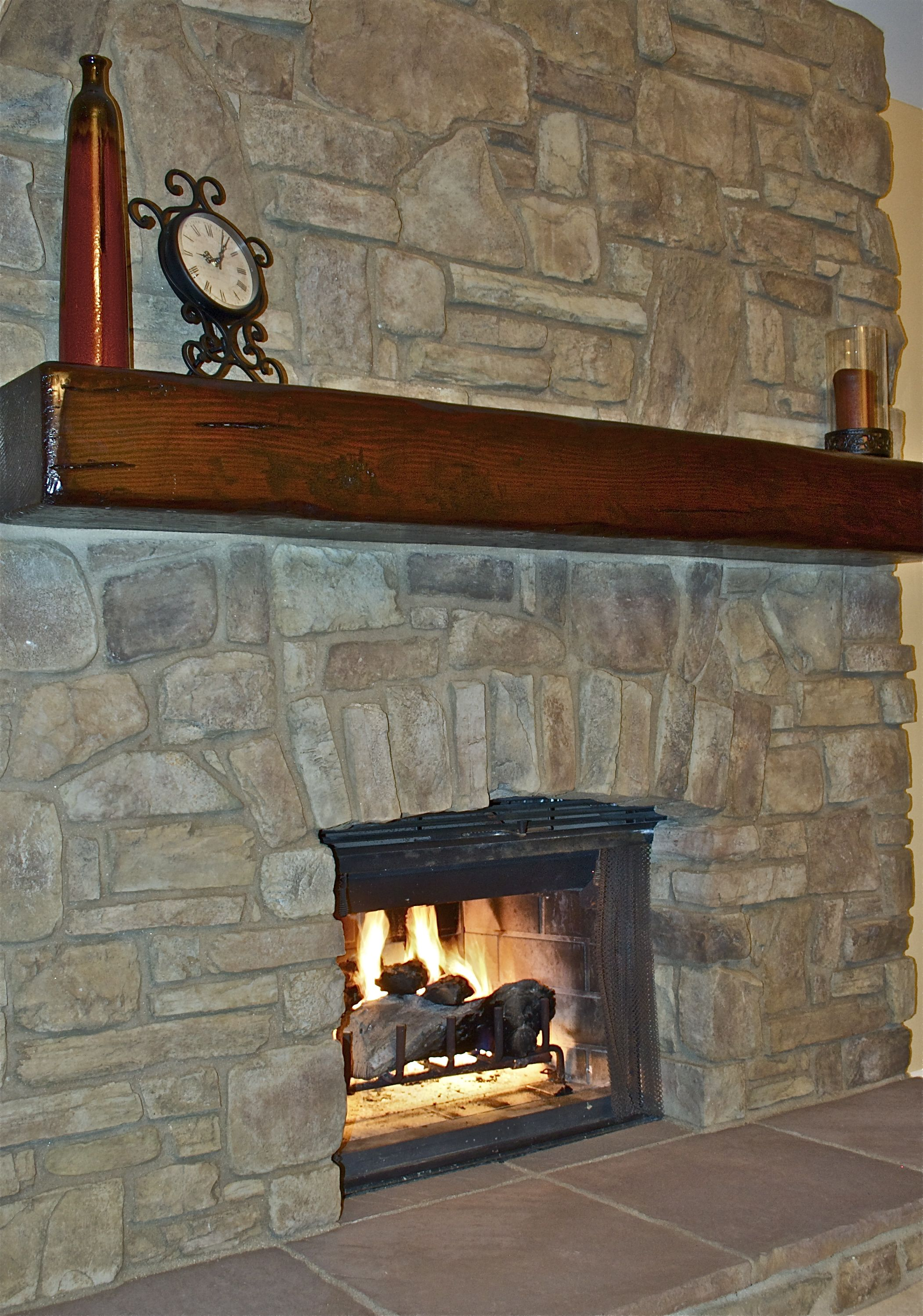 This Wood Beam Mantel Brings The Rustic Look Of Reclaimed Lumber To A Tuscan Inspired Fireplace