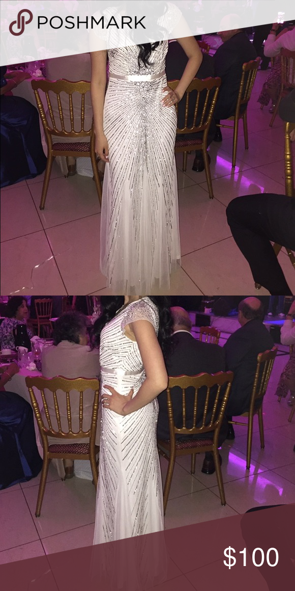 Stunning white and silver dress. Gorgeous dress worn once to engagement party! Fits great super comfortable in great condition, Felt like a princess! Dresses Maxi