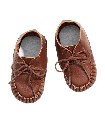 Check this out! BABY EXCLUSIVE/PREMIUM QUALITY. Leather moccasins with underside sewn in one piece. Visible seams at front and back, lacing at top, and soft jersey insoles. - Visit hm.com to see more.