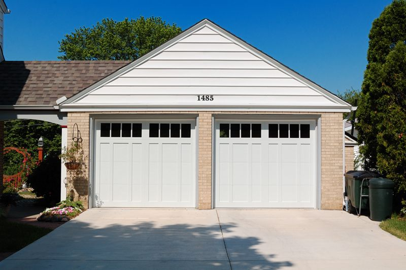 A Simple Brick And White Design Garage Doors Affordable Garage Doors Residential Garage Doors