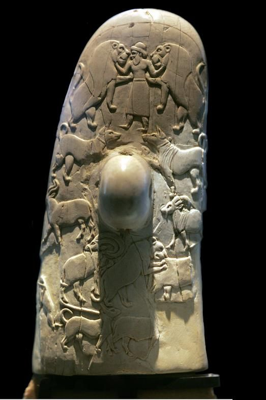 This unique dagger from the late predynastic period consists of a light silex blade, sculpted using a highly sophisticated technique, and an ivory handle featuring carved bas-relief scenes. It is one of the oldest known examples of bas-relief sculpture. The back side of the handle shows the Canaanite god El subduing two lions. Found at Gebel el-Arak in Egypt,  Date: c.3300-3200BC Location: Louvre Museum (left photo by Christian Décamps)