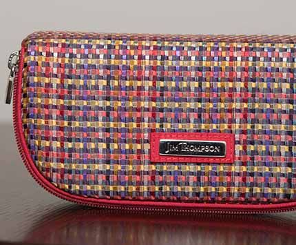b3ec93ee1517 This red border with multiple color patterned Jim Thompson cosmetic case is  beautifully elegant!
