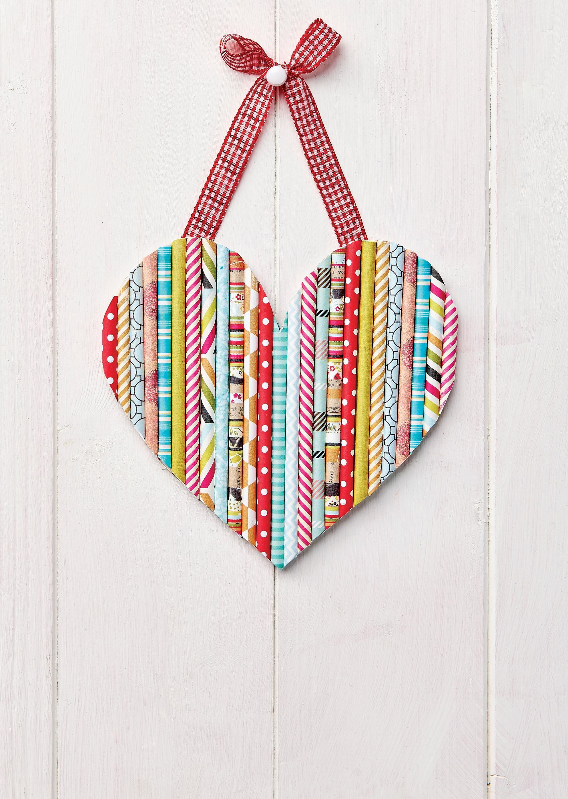Simple yet cute paper craft pretty paper rolled into straw shapes a collection of 25 paper heart projects for valentines day weddings or just because a handmade heart is a simple diy craft tutorial idea jeuxipadfo Gallery