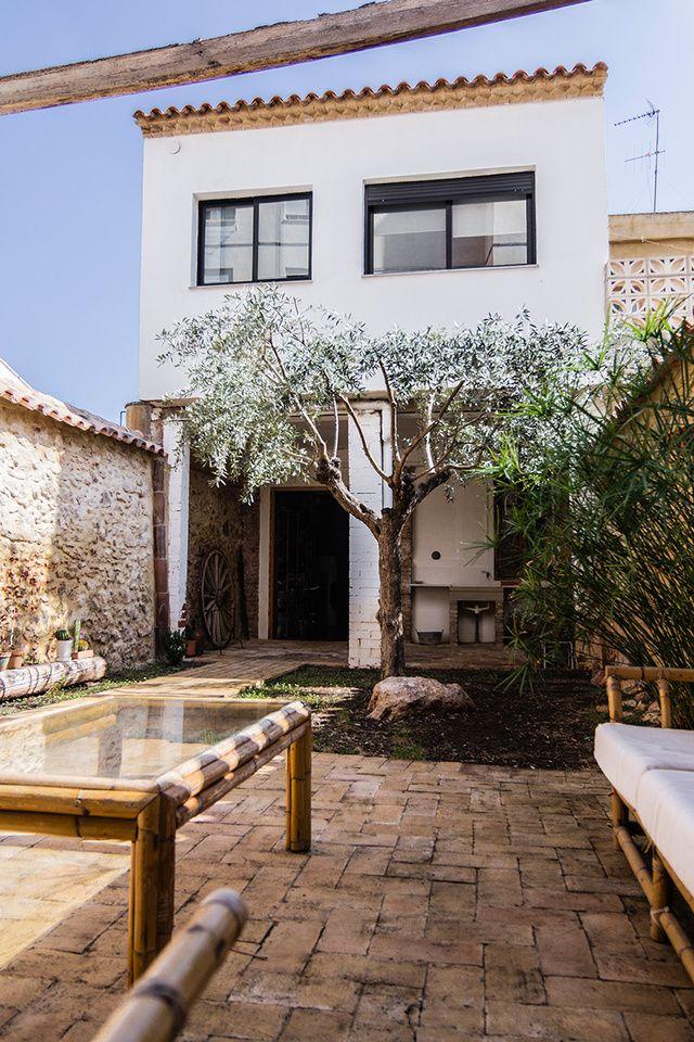Cueva primitiva muro de piedra piedra y cemento pulido - Porche casa moderna ...