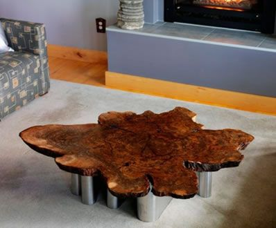 coffee table made with a decaying tree root designedstuart