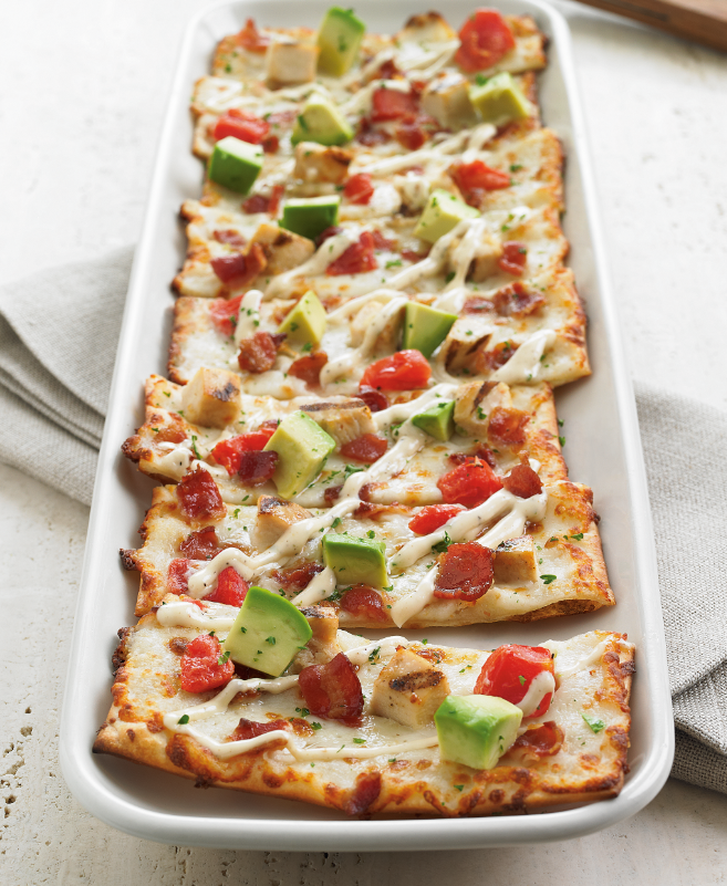 California Flatbread Appetizer Pizza - Grilled Chicken breast, Applewood smoked bacon, tomatoes, mozzarella, roasted garlic aioli and diced avocado. #pizza