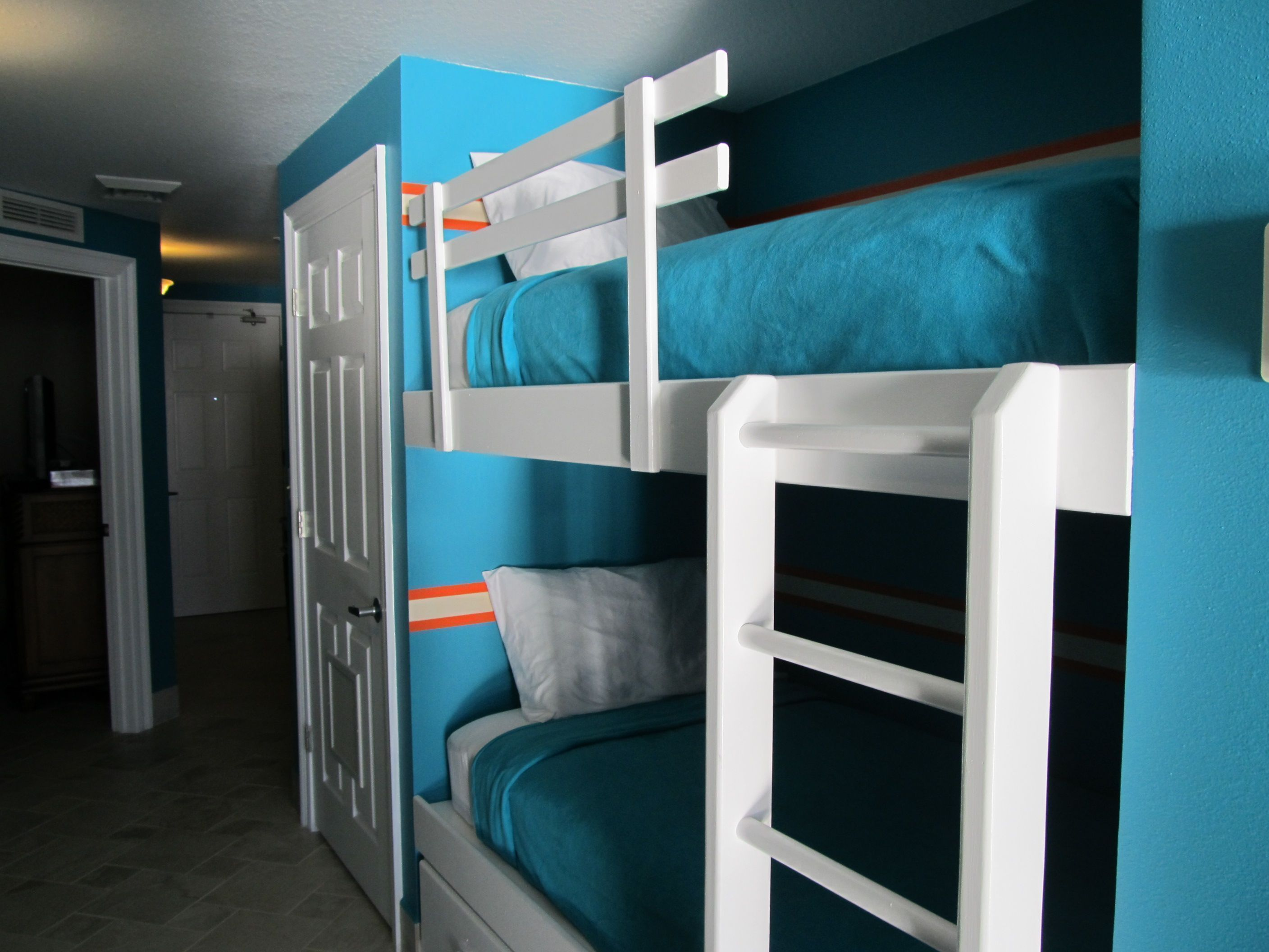 Hallway storage next  Twin bunks in hallway Newly painted wood Brand new mattresses are