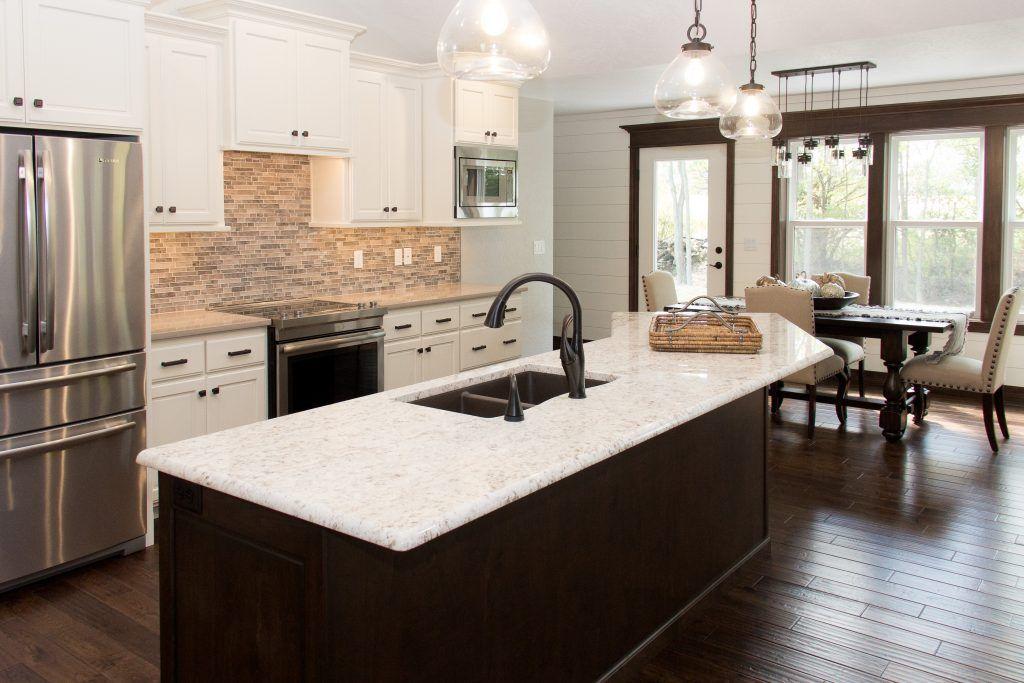 Dark Oak Hardwood Kitchen Floor Tan Tile Kitchen Backsplash Hardwood Floors In Kitchen Kitchen Tiles Backsplash Stone Tiles Kitchen