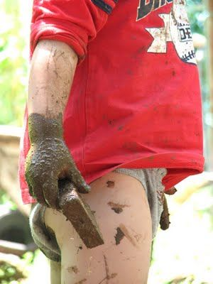 Now this is how a child should look after playing outside.  Muddy and saturated by the joy of digging.  Isn't he ADORABLE!!!  Those little hands!