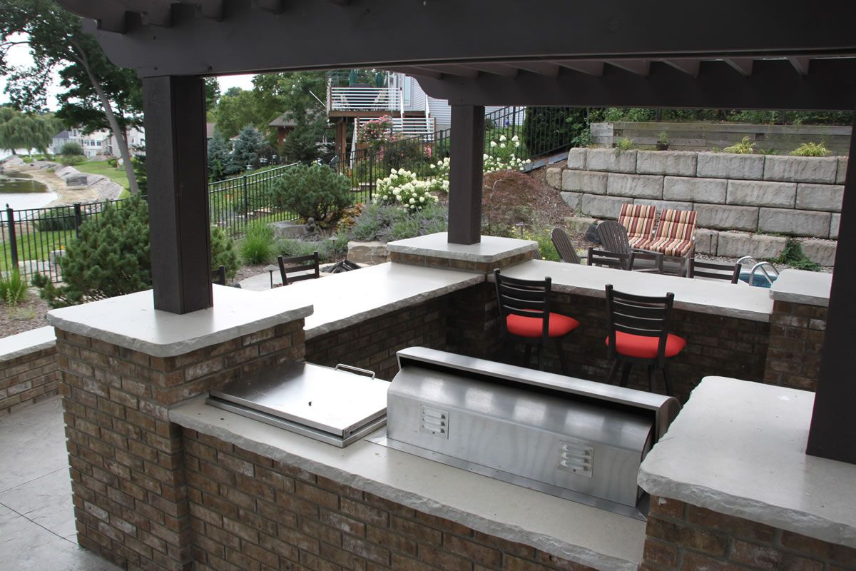 Outdoor white cement countertop that is integrated with bar a pair ...