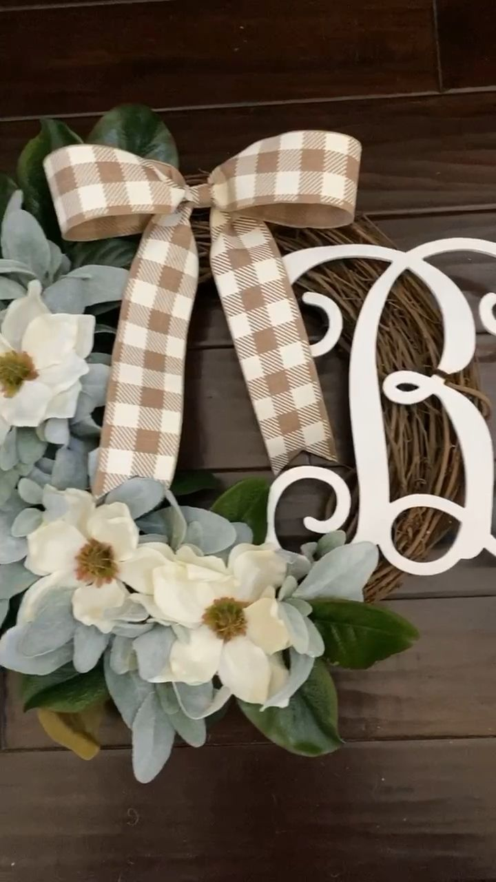 Photo of Our lambs ear and magnolia wreath in our half style with a monogram adds a wonde…